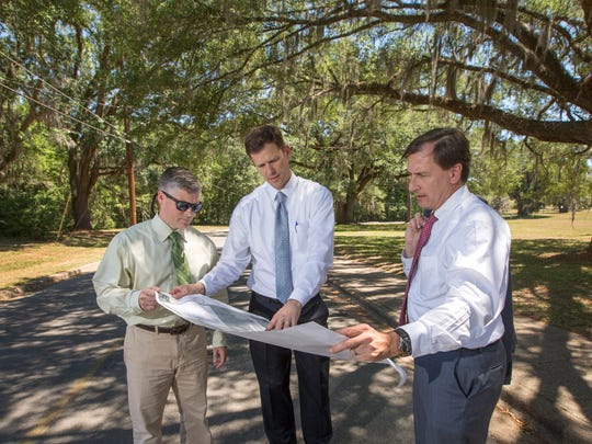 Kevin Graham, executive director, FSU Real Estate Foundation, center, with Associate General Counsel Dustin Dailey, left, and Tom Jennings, VP of University Advancement, right.