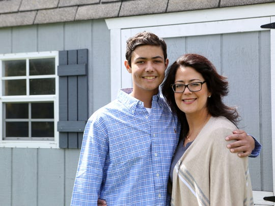 Brandon Johnson, a John Jay High School junior and member of the baseball team has been recovering from a fight with leukemia since last summer. He had a bone marrow transplant in August, donated by his younger sister Madelyn. Brandon, 17, and his mother Susan at home May 11, 2017 in Hopewell Junction.