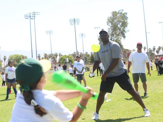 Former Major League Baseball pitcher Darren Oliver pitches to kids at an Major League Baseball funded clinic for kids in Indio on May 13, 2017 at the Davis Sports Complex in Indio.