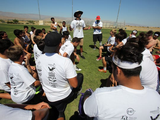 Football players practice at a free football camp hosted by James Dockery, the former corner back for the Cleveland Browns and Carolina Panthers and DJ Alexander Kansas City Chiefs linebacker at Xavier College Preparatory on Saturday, Mary 13, 2017 in Palm Desert.