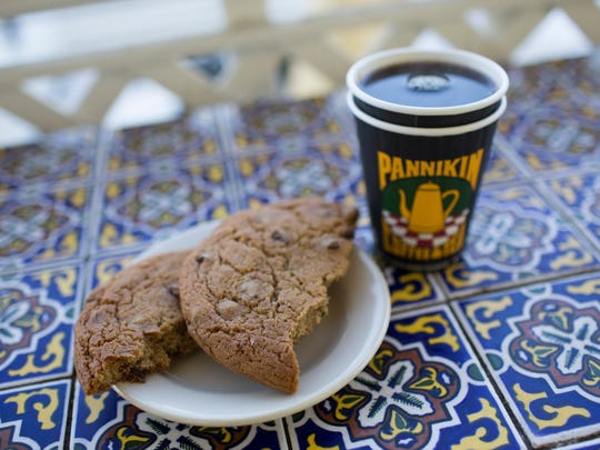 A cookie and a cup of coffee at Pannikin Coffee and