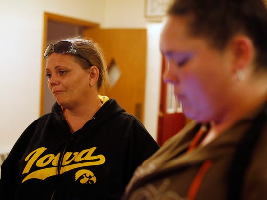 Kari Easter of Des Moines (left), the biological mother of one of the young children removed from the adopted home where Sabrina Ray died, cries as she talks about her daughter Friday, May 19, 2017, following a vigil for Sabrina Ray at First Christian Church in Perry.