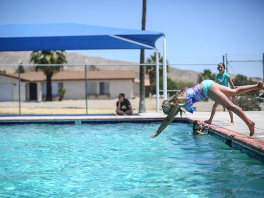 Olivia Peterson, 12, dives into Wardman Park Pool in