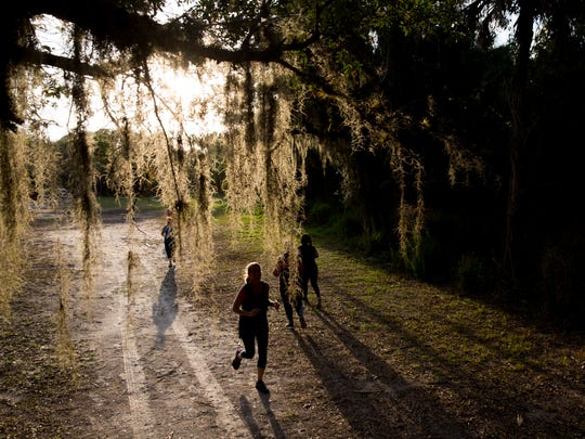 Trainees sprint during one of the final exercises in a one-hour boot camp session at Koreshan State Historic Site on Monday, May 22, 2017, in Estero, Fla. Instructor Johnathan Blevins' routines change from day to day but usually feature plenty of cardio.