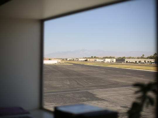 View of Bermuda Dunes Airport's taxiway and runway from executive manager Robert Berriman's office on Tuesday, May 23, 2017. Berriman and others object to the possible site of a orthopedic joint center because of its proximity to the airport.