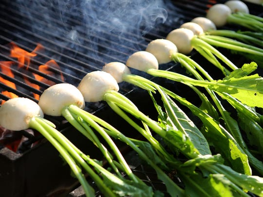 Turnips on the grill for a farm dinner prepared by