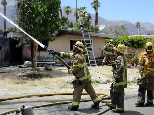 Firefighters put out a house fire in Palm Springs. The American Red Cross responds to mreo than 62,000 disasters each year, with the majority being house fires.