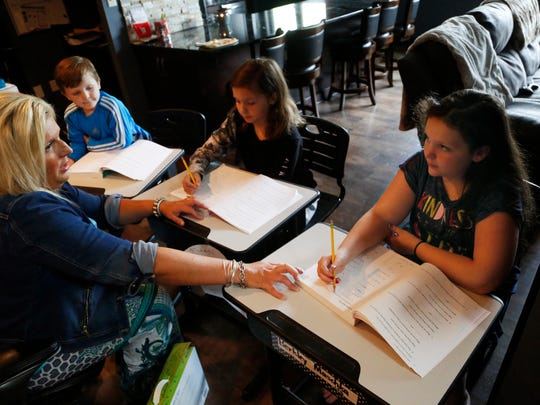 Andrea Maschka, left, goes over math problems with