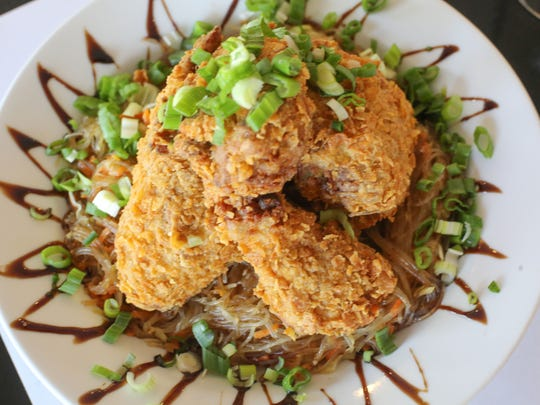 The adobo fried chicken with vegetable pancit at Evzin Mediterranean Restaurant in Palm Desert on Wednesday, May 10, 2017.