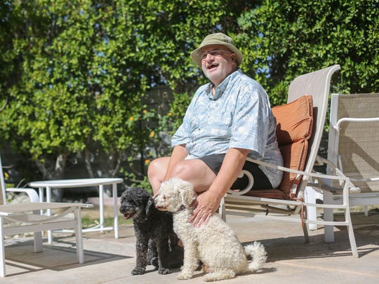 Jim Gross, of Palm Springs, with his dogs Stan, left, and  Ollie on May 26, 2017, in Palm Springs. Gross didn't take care of his skin from the sun until he got skin cancer on his chest, nose and scalp. Now he uses sun screen and hats when  outdoors.
