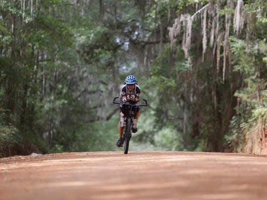 Local cyclist Rick Ashton rides down Old Centerville Road May 29 as he prepares for the Tour Divide. Ashton will participate in the more than 2500-mile self-supported mountain bike race for the third time this June.