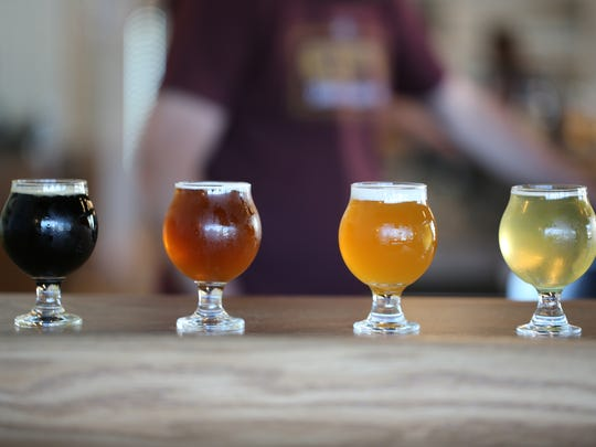 A selection of Axle Brewing Co. beers from the local beer brand's new brewery, Livernois Tap, debuting in Ferndale June 3, 2017.