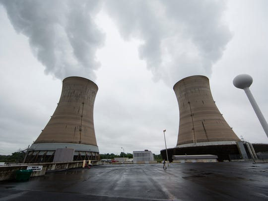 A Monday, May 22, 2017, file photo shows cooling towers at the Three Mile Island nuclear power plant in Middletown, Pennsylvania. Exelon Corp., the owner of Three Mile Island, site of the United States' worst commercial nuclear power accident, said Monday, May 29, 2017, it will shut down the plant in 2019 unless it receives a financial rescue from Pennsylvania. (AP Photo/Matt Rourke, File)