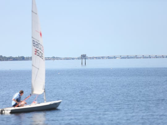 The 25 mph sign stands on the edge of the Caloosahatchee