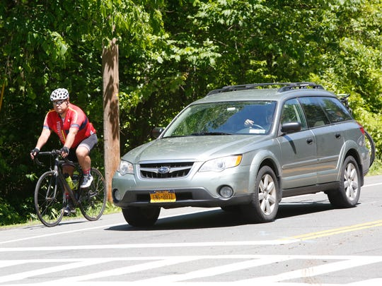 Bikers and vehicles at the intersection of Route 9W and Oak Tree Road in Palisades on Jun. 1, 2017.  Residents are fighting to get the speed limit lowered and some changes to the road which they say is dangerous because of the volume of traffic and bicyclists who travel it on a daily basis.  They cite numerous accidents that has taken place this year alone.
