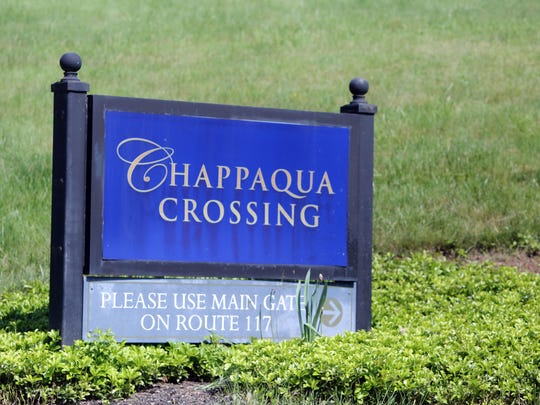 A sign for Chappaqua Crossing near the intersection