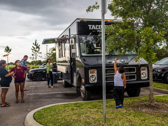 "People wait for their food outside of the new taco truck, ""Taco Tummy"", in Ave Maria on Thursday, June 2, 2017. Three brothers, Gabriel, Luis and Mark Trejo opened their taco truck on May 5."