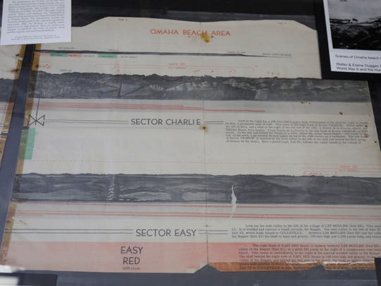 """This chart detailing the environmental features of Omaha Beach, pictured June 5 at FSU's Institute on Wold War II and the Human Experience, was distributed to troops who were to take part in the invasion of Normandy as part of a larger packet entitled """"Defenses as of May 14, 1944."""""""