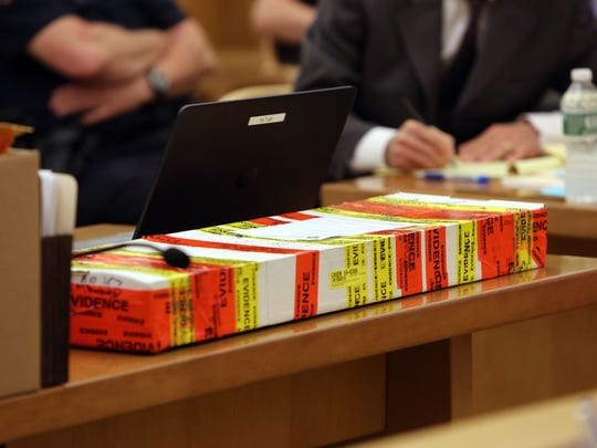 Evidence on the prosecutor's desk on the first day of trial for Hengjun Chao for trying to kill his former boss, Dr. Dennis Charney, at Lange's in Chappaqua last summer, June 5, 2017 at Westchester County Courthouse in White Plains.