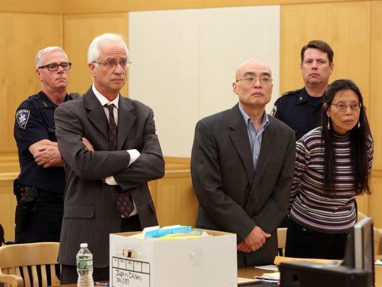 Defense lawyer Stewart Orden, left, with client Hengjun
