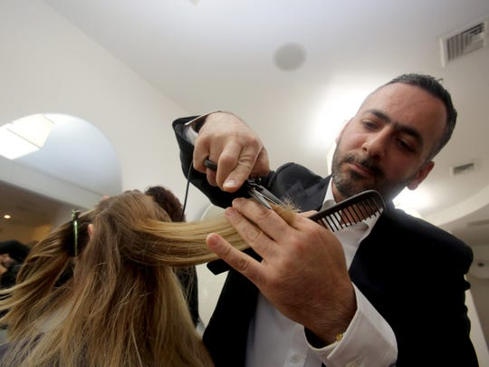 Nuriel Abramov, owner of Numi Salon in Rye, uses Jaguar scissors to cut hair June 7, 2017. Abramov says that the blades reduce the frequency of haircuts and also reduces split ends.