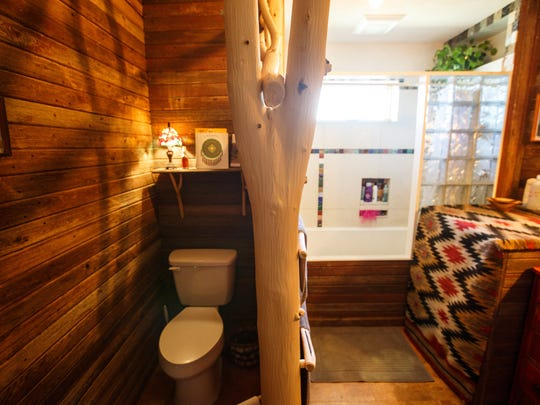 Susan Walch  designed a wall to separate the toilet