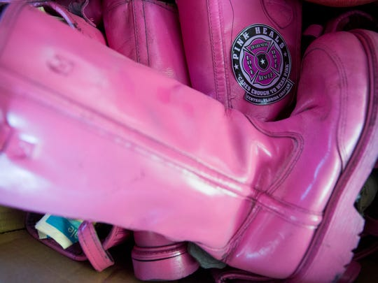 Pink boots sit in the cab of the donated fire engine outside of Maaco Collision Repair & Auto Painting Thursday, June 8, 2017 in Naples.