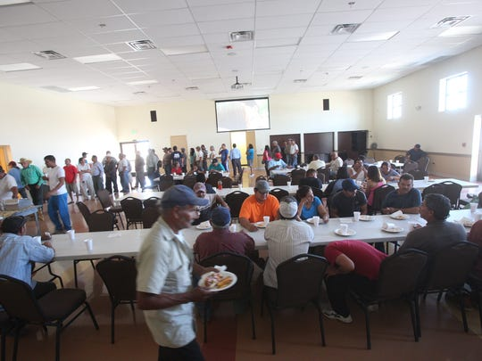 Farmworkers get relief from the heat and our fed at the Galilee Center in Mecca on June 8, 2017.