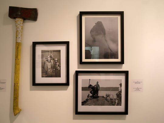 Photographs and some antiquated equipment on display at Urban Studio Unbound gallery in Yonkers.