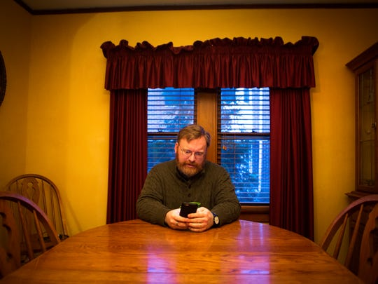 Michael Vanderburgh starts his morning at his kitchen table, answering email before heading out for a day of phone calls and meetings.