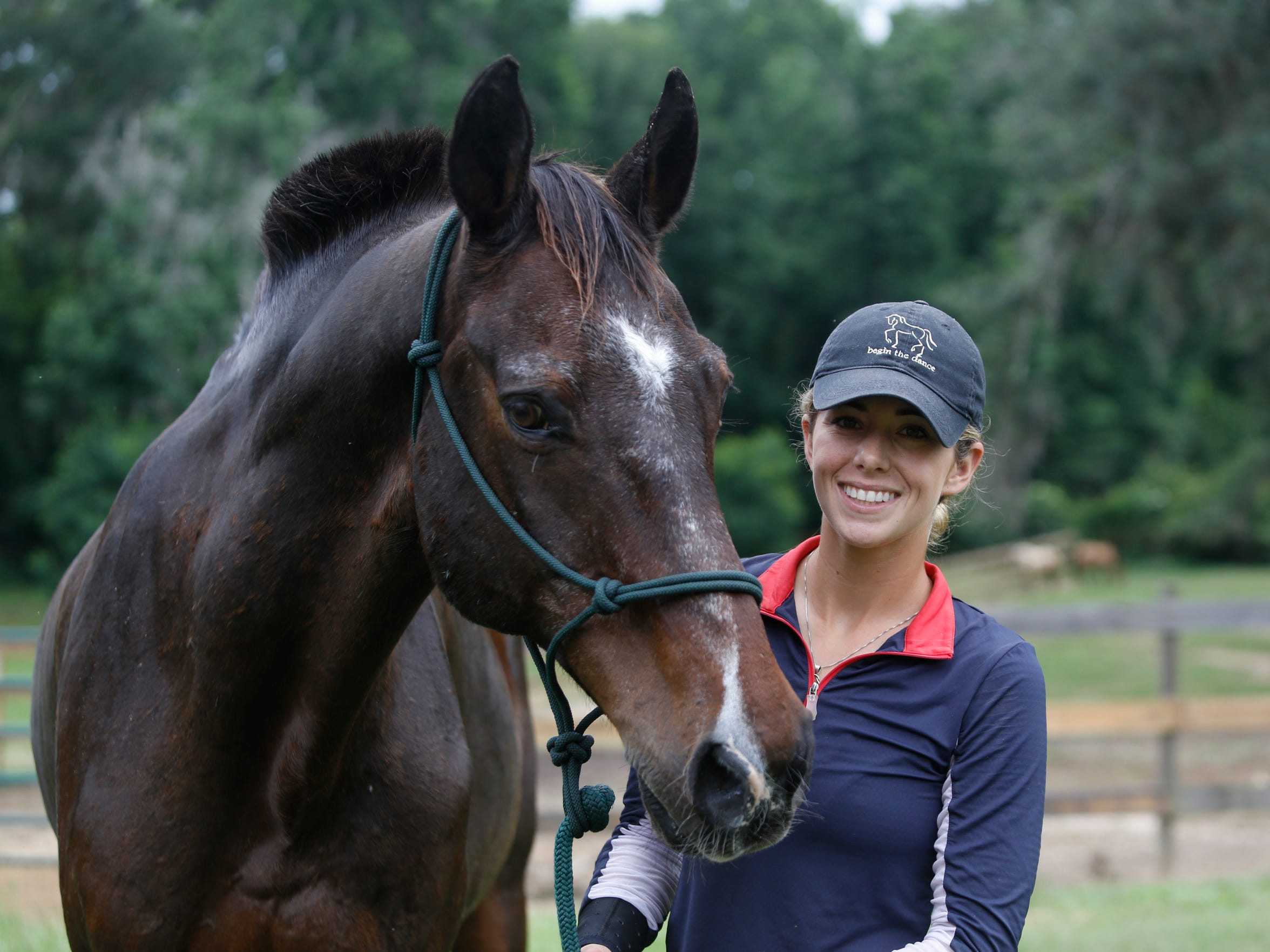 Assistant trainer Ashley Mancuso poses with her horse