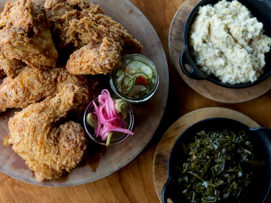 June 10, 2017 - Memphis, TN: The fried chicken for two with collard greens and farm grits at Sweetgrass in Cooper-Young.