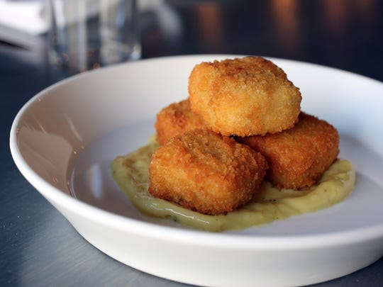 Grit and cheddar croquettes with garlic aioli at Essie's Restaurant on Mount Carmel Place in Poughkeepsie, June 13, 2017.