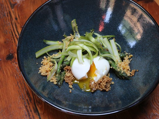 Asparagus with a hen egg, preserved mustard seeds,