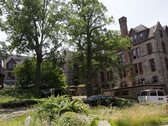 Local officials gathered Tuesday to usher in work on a $64.5-million luxury apartment development that will also transform the former St. Mary's Convent and chapel into a 42-room inn with spa and restaurant.