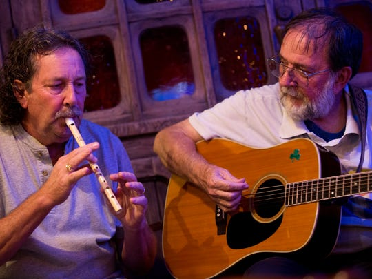 Jim McEvoy, left, and Brian Brown play an impromptu set during Irish Music Night at Riptide Brewing Company Wednesday, June 14, 2017 in Naples. The weekly tradition brings like minded musicians together to experiment with Irish songs.