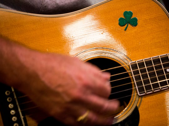 Jim McEvoy, from left, Brian Brown, and Mark Kartzinel play an impromptu set during Irish Music Night at Riptide Brewing Company Wednesday, June 14, 2017 in Naples. The weekly tradition brings like minded musicians together to experiment with Irish songs.