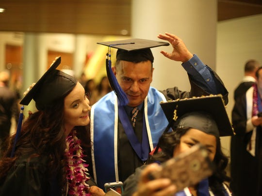 Edgar Rivera, of Indio, pose for a selfie with fellow graduates Jennifer Gomez, 27, and Raquel de Gonzalo, 30 at the Cal State San Bernardino Palm Desert Campus' Class of 2017 commencement ceremony on Thursday, June 14, 2017 at The Show in Rancho Mirage. Rivera became addicted to drugs at the age of 16 and has been sober for 10 years. Rivera plans to become a therapist.