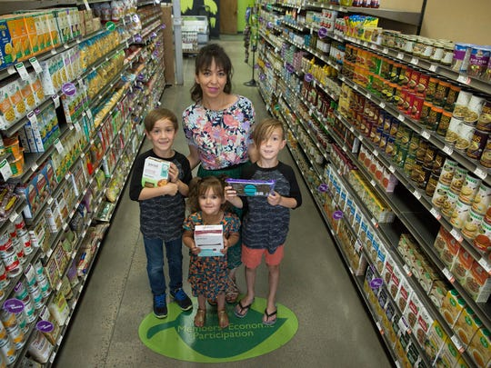 Tessa Stuve, center, along with her kids Luca, 8, left, Persephone,3, and Elliot 8, in MountainView Market Co-Op. People who have a first-degree relative with celiac disease, have a higher risk of developing the illness.