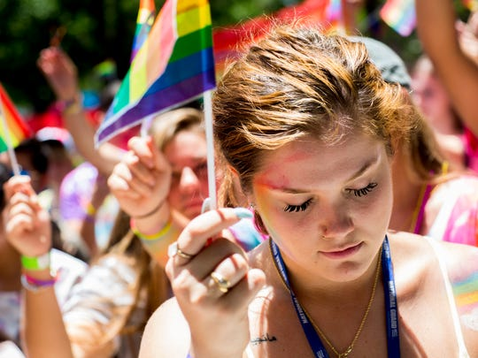 Silvia Mangiapane, 18, bows her head during a moment of silence for the victims of the Orlando Pulse attack during the first-ever Naples Pride at Cambier Park Saturday, June 17, 2017 in Naples.
