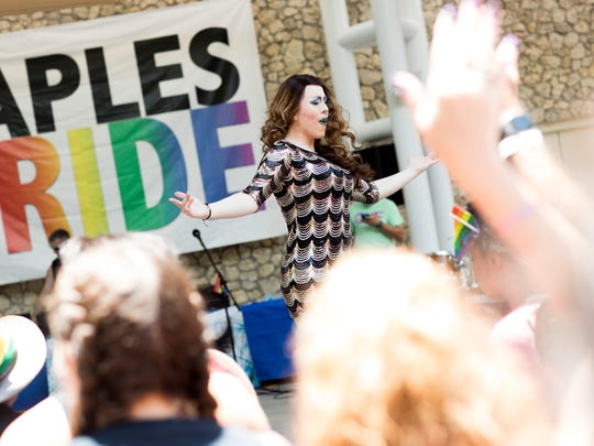 Supporters of the LGBTQ community come together to celebrate the first-ever Naples Pride at Cambier Park Saturday, June 17, 2017 in Naples.