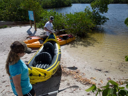 Suzanne and Minch Minchin carry their inflatable kayak into the water at Lovers Key State Park on June 18, 2017 in Fort Myers Beach, Florida. There are plans to build a 3500 square foot visitor center so regardless of weather, people can still come and enjoy educational programs inside this new space.