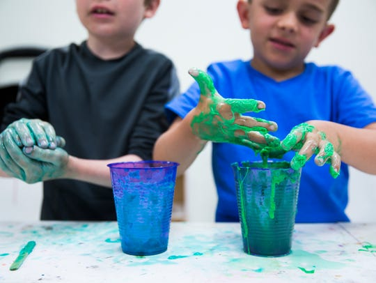 Students play with their newly made slime on Tuesday,