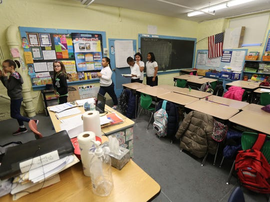 Students leave a basement classroom in the 112-year old School 17 on Midland Avenue in Yonkers.