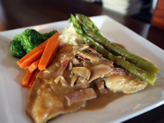 Francey's Favorite is pan seared chicken breast, Irish bacon, button mushrooms, chopped asparagus, Jameson whiskey cream sauce and whipped potatoes.