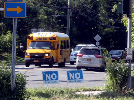 Signs urging voters to vote no in the East Ramapo school budget were posted at the intersection of Grandview Ave. and Route 306 in New Hempstead June, 20, 2017. Voters in the school district were voting on the revised budget Tuesday after the first budget was defeated in the May 16th elections.