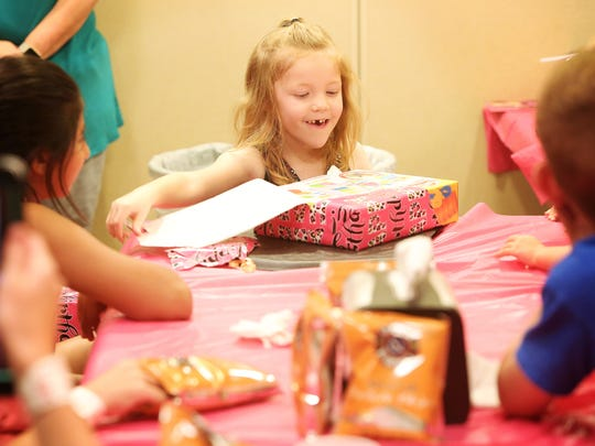 Addyson Benton opens gifts during her sixth birthday