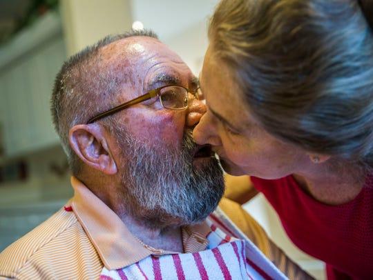 Linda Ragsdale, 75, kisses her husband George Otto,