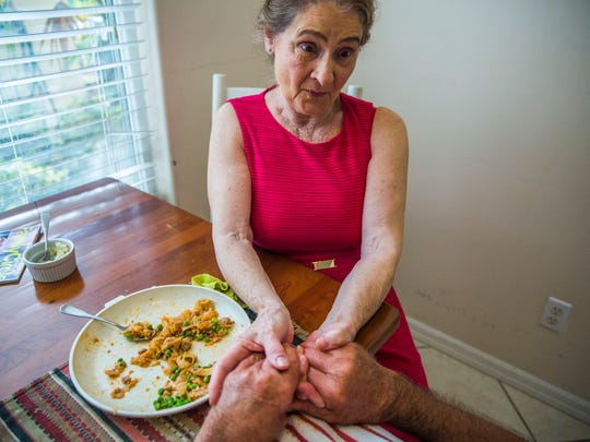 Linda Ragsdale, 75, talks to her husband George Otto, 86, while feeding him dinner in his Naples home on Tuesday, June 20, 2017. The couple got married in 2008 and Otto was diagnosed with Alzheimer's disease in 2010. Ragsdale lives next door to her husband and gets assistance from caregivers.