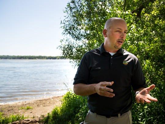 Iowa DNR district fisheries biologist Mike Hawkins speaks about the Curly-leaf pondweed in East Okoboji Lake Wednesday, June 14, 2017.